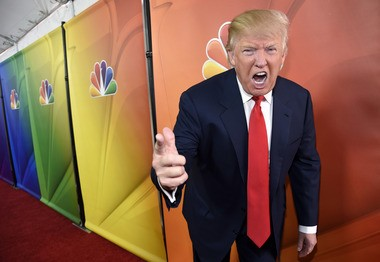 """In this Jan. 16, 2015 file photo, Donald Trump, host of the reality television series """"The Celebrity Apprentice,"""" poses for photographers at the NBC 2015 Winter TCA Press Tour in Pasadena, Calif."""