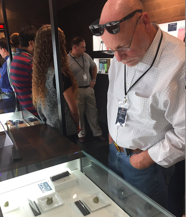 Assemblyman Jim Kennedy (D-Union) inspects a display case at GroundSwell Cannabis Boutique in Denver. (Photo Courtesy of Senate Majority Office)