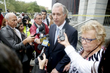 New Jersey Assemblyman John Wisniewski, center, talks to the media after the end of the first day of the trial as Sen. Loretta Weinberg listens.