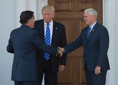 Former Massachusetts Gov. Mitt Romney (left) meets with President-elect Donald Trump and Vice President-elect Mike Pennce outside the clubhouse of Trump National Golf Club in Bedminster on Saturday afternoon.