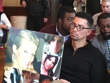 Ricardo Rivera of Oaklyn holds a poster full of photos of his sister who died from a heroin overdose in 2015. He asked a state panel to include chronic pain among the conditions that let people qualify for the medical marijuana program, because he said opioids are too addictive.