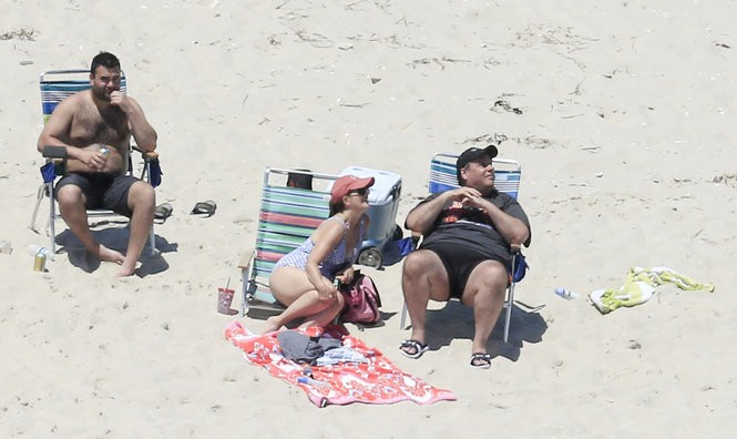 Gov. Chris Christie (right) and his family and friends are shown Sunday at Island Beach State Park, which was closed to the public due to the state government shutdown. (Photo by Andrew Mills | NJ Advance Media)