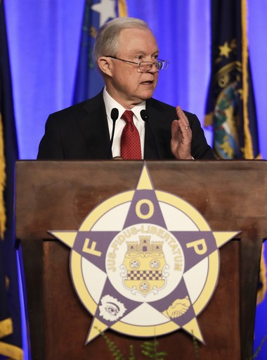 Attorney General Jeff Sessions speaks at the Fraternal Order of Police convention Monday in Nashville, Tenn. Sessions said President Donald Trump will revive a program that provides local police departments with surplus military equipment such as high-caliber weapons and grenade launchers.