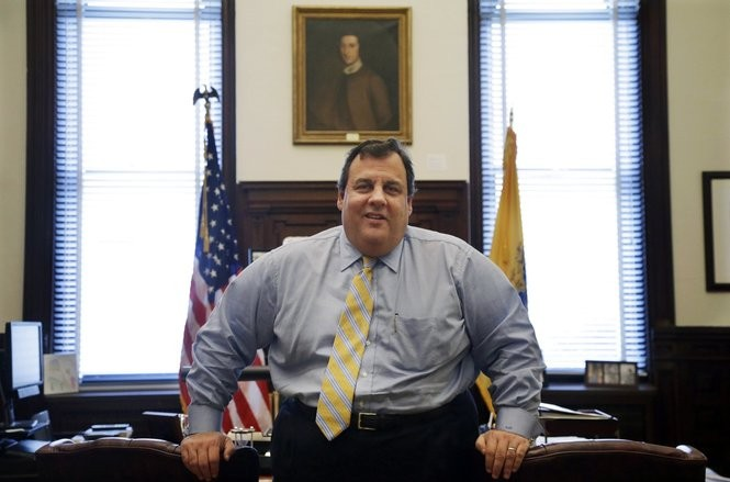 In this Jan. 4, 2013, photo, New Jersey Gov. Chris Christie poses for a photo in his office at the Statehouse in Trenton, N.J.