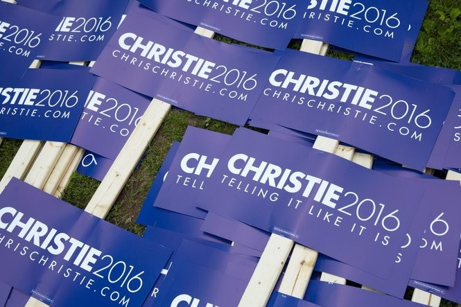 Christie 2016 signs are collected. NJ Gov. Chris Christie walks in the Wolfeboro, NH, 4th of July Parade. Saturday July 4, 2015. Wolfeboro, N.H.