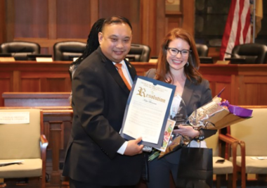 Jersey City Council President Rolando Lovarro Jr. presents Katie Brennan a Women of Action resolution last March. (Photo courtesy of the Jersey City Council)