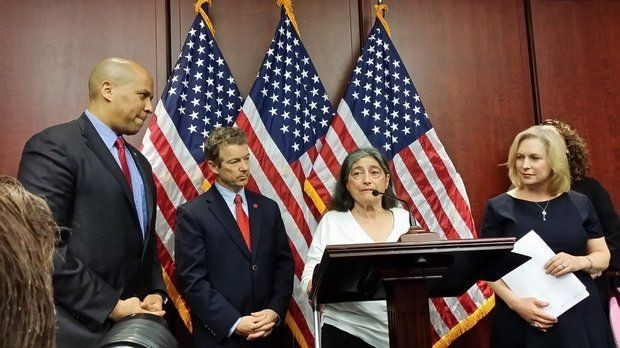 Sandy Faiola of Asbury Park, who has multiple sclerosis, speaks at a Capitol Hill press conference, joined by (left to right) Sens. Cory Booker (D-N.J.), Rand Paul (R-Ky.) and Kirsten Gillibrand (D-N.Y.) (Jonathan D. Salant | NJ Advance Media for NJ.com)