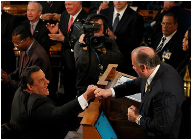 Gov. Chris Christie and Senate President Steve Sweeney share a fist bump before Christie's State of the State speech.