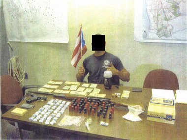 This photo apparently depicts a New Jersey State Police trooper holding a Puerto Rican flag after a 2009 drug and weapons bust in Camden. State Police said they are investigating this and other photos.