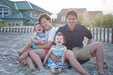 Julie Rosenberger, who was diagnosed with breast cancer at age 33, shown here with her husband and twin daughters.