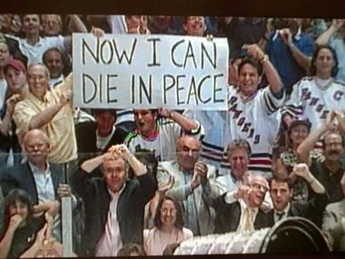 A screen shot from Game 7 in 1994 made the sign, but not the men holding it, famous.