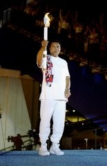 Muhammad Ali holds the torch before lighting the Olympic Flame during the Opening Ceremony of the 1996 Centennial Olympic Games in Atlanta, Georgia. (Michael Cooper)