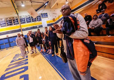 Paterson Eastside head coach Juan Griles with his team after a recent loss to St. Joseph (Mont.)