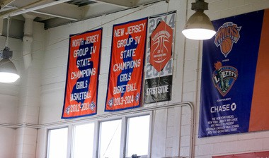 Girls championship banners hang in the gym at Eastside High. (Andrew Mills | NJ Advance Media for NJ.com)