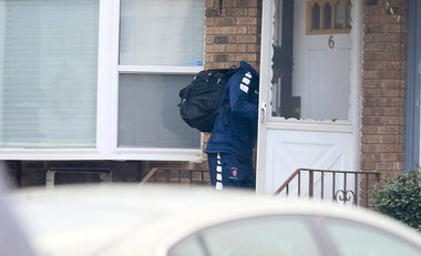 The second of five players emerge from the home of head coach Juan Griles a day after he said only two of his Paterson Eastside basketball players are living with him at his home on E. 19th Street. (Andrew Mills | NJ Advance Media for NJ.com)