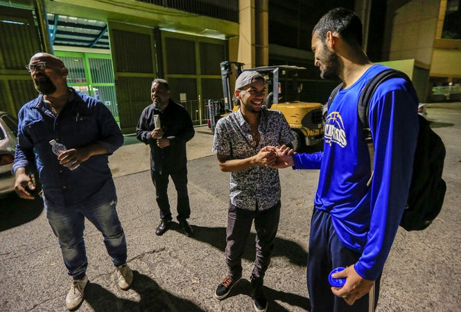 Christian Ortiz (backwards hat) and Selwyn Rodriguez (far right) chat outside the Ruben Rodriguez Coliseum in Puerto Rico. (Andrew Mills | NJ Advance Media for NJ.com)