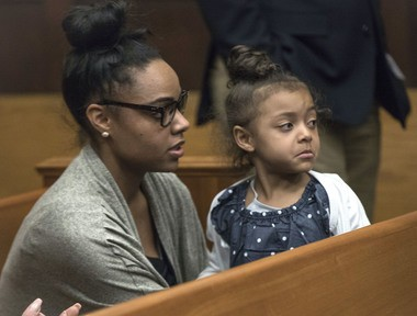 Shayanna Jenkins Hernandez, fiancee of former New England Patriots tight end Aaron Hernandez, sits in the courtroom with the couple's daughter on April 12, 2017. (Keith Bedford | The Boston Globe via AP, Pool)