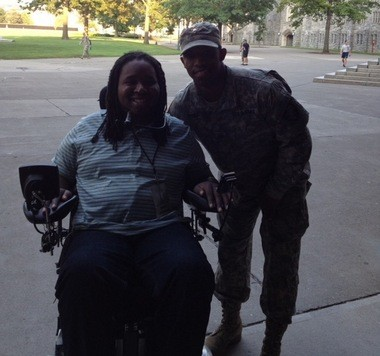 A photo of Eric LeGrand and Malcolm Brown from LeGrand's visit to West Point in 2012. Brown uses the photo as his computer background as a reminder of LeGrand's inspiration.