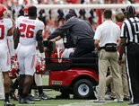 Rutgers linebacker Greg Jones is carted off the field after getting injured during the first half of an NCAA college football game against Ohio State, Saturday, Oct. 1, 2016, in Columbus, Ohio. (AP Photo/Jay LaPrete)
