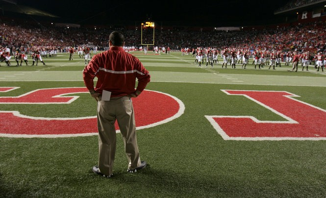 Rutgers head coach Greg Schiano surveys the scene before the start of the 2006 Louisville game. Schiano, more than anyone else, believed that New Jersey could be the home to big-time college football.
