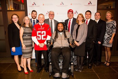 Eric LeGrand poses with members of Newroads Financial Group, which hosted a fundraiser that generated $46,000 for Team LeGrand.