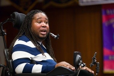 Eric LeGrand speaks to a crowd at Rutgers University School of Management and Labor Relations as part of the 250th anniversary celebration.