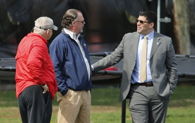 Rutgers booster Jeff Towers (center) and 1995 All-American tight end Marco Battaglia engage in a conversation at a football practice.