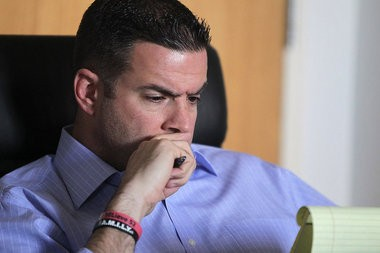 Rutgers athletic director Tim Pernetti watches a video of Rutgers basketball coach Mike Rice pushing and throwing basketballs at players .