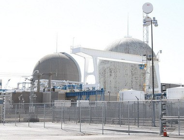 PSEG Nuclear's Salem 1 reactor, seen at left, was returned to service this afternoon after being shut down because of a leaking valve in its reactor coolant system. The plant was shut down on Thursday night.