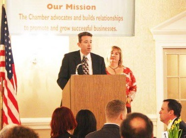 Salem County Chamber of Commerce officer Joe Delmar, left, along with chamber Executive director Jennifer Jones discuss the chamber's updated mission statement during the chamber's 2013 Spring Banquet at the Centerton Country Club in Pittsgrove Township Thursday night.