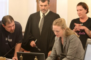 Scott Bertle, left, Judge John Jordan, Pennsville Municipal Prosecutor Jean Chetney and Amy Krepski watch a security video of the event during court. Scott D. Bertles of Pennsville is facing animal cruelty charges stemming from a stabbing of neighbors dog back in May of 2013. Bertles was in Pennsville Municipal Court presenting his case, Wednesday, Aug. 28, 2013. The injured dog was euthanized.