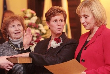 Lt. Gov. Kim Guadagno, right, swears-in Freeholder Director Julie Acton, center, during the Salem County reorganization meeting at the Old Courthouse, Wednesday, Jan. 8, 2014. Also pictured, Jean Gross, Acton's mother. (Staff Photo by Britney Lillya/South Jersey Times)