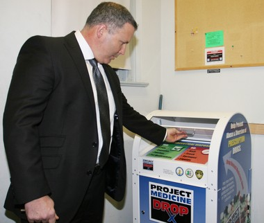 Pennsville Police Chief Allen J. Cummings uses the prescription drug drop box located in the police station. (File Photo)