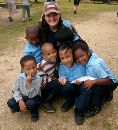 Pictured is Jessie Keen in Belize with children she reached out to during her trip in November. (Submitted Photo)