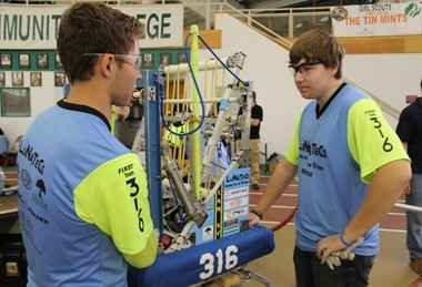 """Co-caption and driver for the LuNaTeCs, Wyatt Retknowski, 17, of Carneys Point and co-captain Justin Pharo, 16, of Penns Grove, standing next to their team's robot named """"SAM"""" (Small And Mighty) at the """"Duel on the Delaware"""" Robotics Competition on Saturday held at Salem Community College's DuPont Field House. (Spencer Kent 