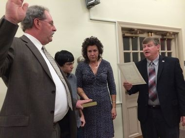 H. Kirk Craver is sworn in to a three-year term on the PIttsgrove Township Committee alongside family during the annual reorganization meeting at the municipal building Friday, Jan. 2, 2014 (Brittany M. Wehner | South Jersey Times)