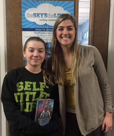 Sixth-grade teacher Chelsea Collins stands with Sky's the Limit contest winner student Mia Ottaviano at Woodstown Middle School, Friday, Jan. 23, 2015 (Submitted Photo | South Jersey Times)