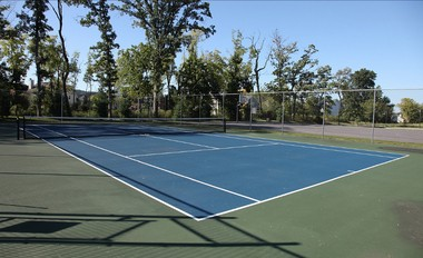 A tennis court is one of the amenities featured at Segal & Morel's Riverview Estates.