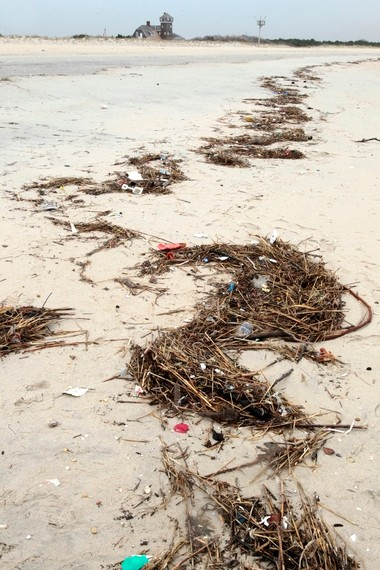 Trash washes up on the beach in Sandy Hook.