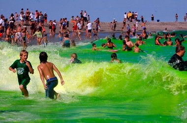 Green fun: Hundreds of people line the beach and swim during the annual end of the summer celebration in Allenhurst. Members of the Allenhurst Beach Club dye the ocean green for this celebration - a town tradition started in the 1940s.