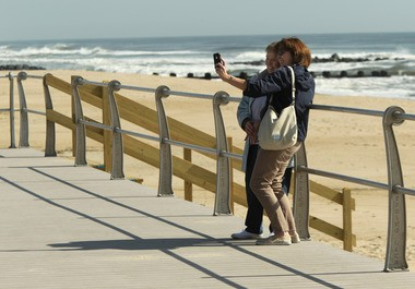 Jersey City natives Nancy Fahy of Greensboro, N.C., and her daughter Mary Steimel of Sacramento, California, take photos on the Spring Lake boardwalk in April 2013.
