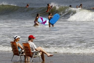 Beach-goers relax on the sand and in the surf in Ocean Grove in August 2012. Ocean temperatures that month were the warmest they've been in years.