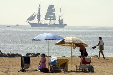 A tall ship makes maneuvers less than a mile from the beach in Sea Girt on a warm and hazy morning in September 2007.