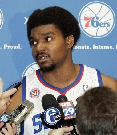 Philadelphia 76ers' Andrew Bynum answers questions about his injury during their NBA basketball media day at the team's practice facility, Monday, Oct. 1, 2012, in Philadelphia. Bynum continues to progress as he looks to finally make his season debut. (AP Photo/Tom Mihalek)