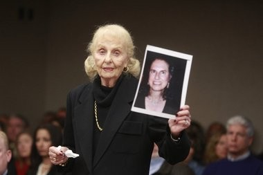 """Marcia Zucker holds up a photo of her late daughter, Helene Seeman, during the sentencing of Amy Locane Bovenizer the one-time """"Melrose Place"""" actress. Bovenizer is being sentenced for the June 27, 2010 fatal auto accident that killed Helene Seeman, and critically injured her husband, Fred Seeman."""