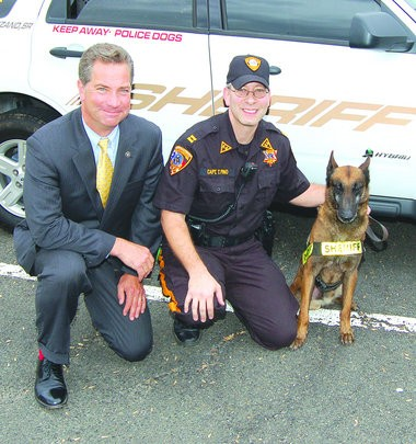 Somerset County Prosecutor Geoffrey Soriano, left, poses with Sheriff's Office Capt. Tim Pino and K-9 Dano.
