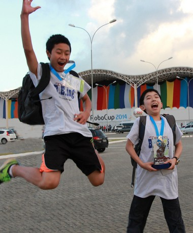 Joseph Chen and Ethan Wu of Team BEing celebrate their victory at the 2014 RoboCup Junior World Championship.