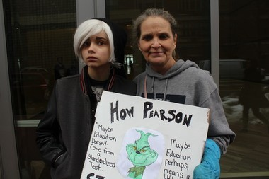 Susan Everett and of her daughter Ally, who is opting out of PARCC in North Brunswick, were among those protesting outside Pearson's offices in Hoboken earlier this month. (Laura Herzog | NJ Advance Media for NJ.com)