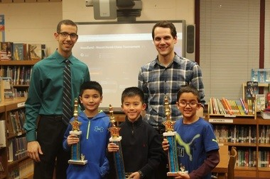 Front row, Alexander Maloney finished third, Tyler Ren, first, and Ethan Rajan, second, in the Warren Township School District Interscholastic Chess Tournament. They are joined by, back row, chess club facilitators Justin Guglielmino from Mt. Horeb School and Woodland School's PJ Jones.