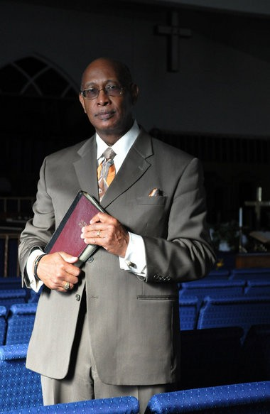 Pastor Clabon Bogan Jr. poses in the sanctuary of the First Baptist Church of Jericho in Deptford, Sunday, Jan. 19, 2014. Bogan is celebrating 20 years as the pastor of the church. (Staff Photo by Joe Warner/South Jersey Times)